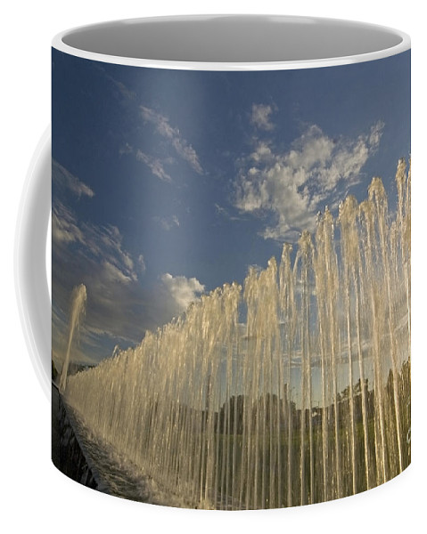 Fountain Coffee Mug featuring the photograph Fountain With Sunlight From The Side by Sven Brogren