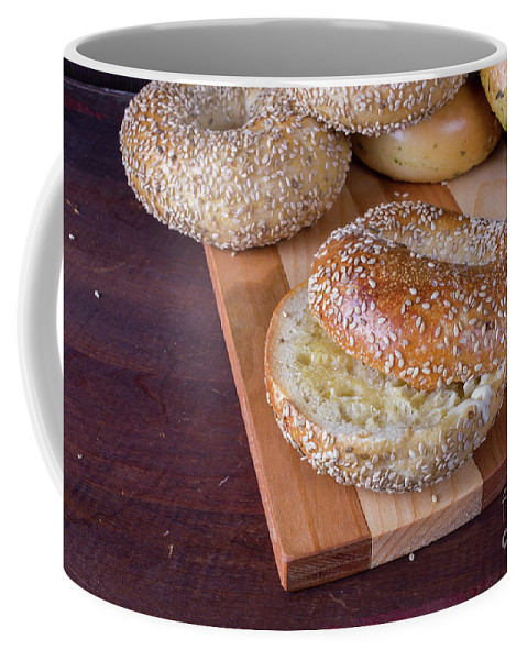 Food Coffee Mug featuring the photograph Fresh Sesame Bagel by Edward Fielding