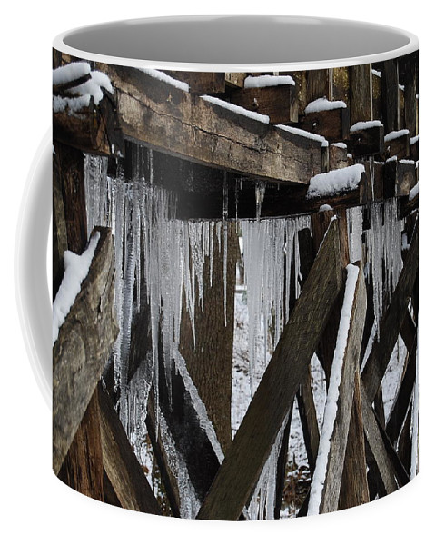 Ice Coffee Mug featuring the photograph Frozen Leaks by Eric Liller