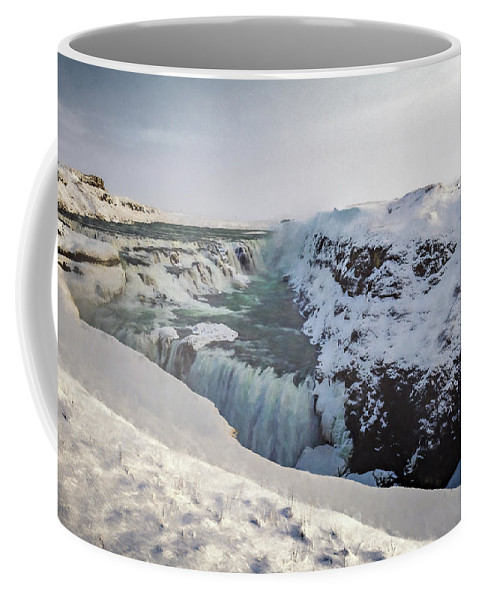 Arctic Coffee Mug featuring the photograph Frozen Waterfall by Maria Coulson