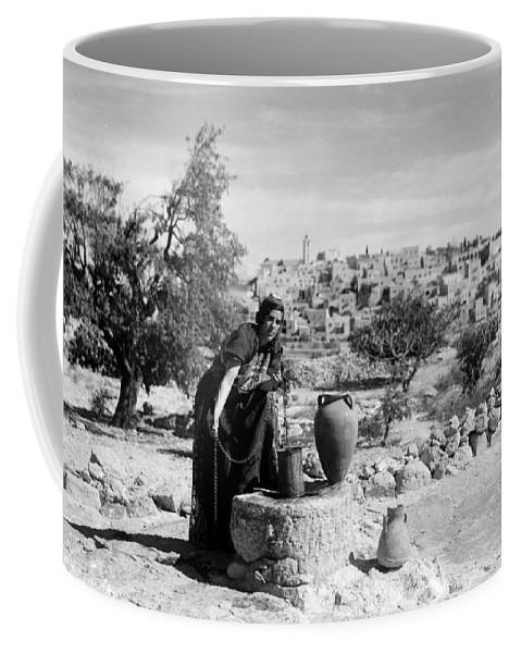 Bethlehem Coffee Mug featuring the photograph Getting The Water by Munir Alawi