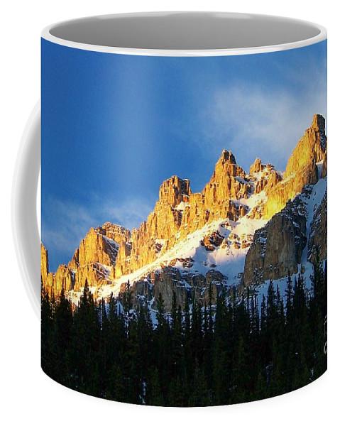 Sun Coffee Mug featuring the photograph Gilded Ridge by Greg Hammond