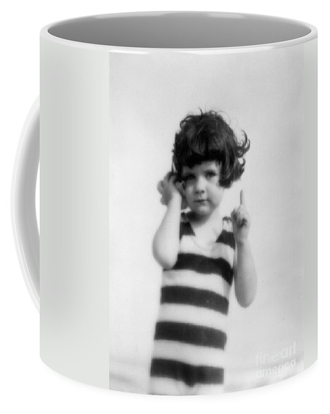 1920s Coffee Mug featuring the photograph Girl Holding Seashell To Ear, C.1920s by H Armstrong Roberts and ClassicStock