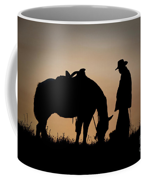Cowboy And Horse Coffee Mug featuring the photograph Going Home by Sandra Bronstein