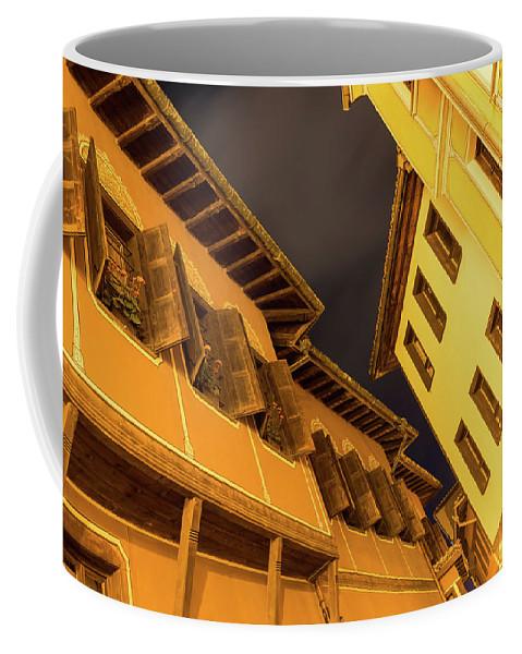 Georgia Mizuleva Coffee Mug featuring the photograph Golden Yellow Night - Chic Zigzags Of Oriel Windows And Serrated Roof Lines by Georgia Mizuleva