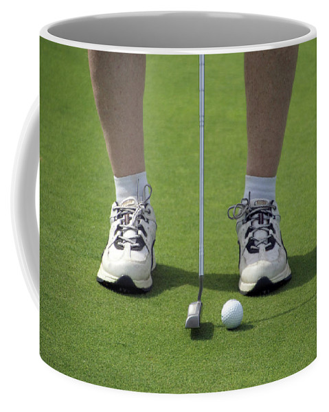 New York Coffee Mug featuring the photograph Golfing Lining Up The Putt by Thomas Woolworth