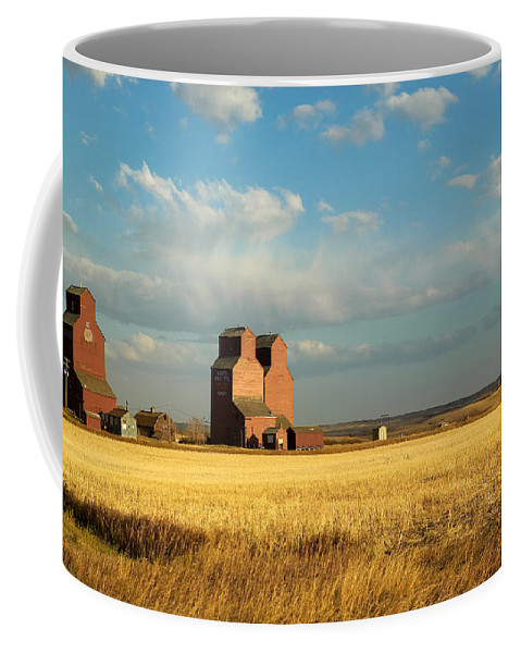 Day Coffee Mug featuring the photograph Grain Elevators Stand In A Prairie by Pete Ryan
