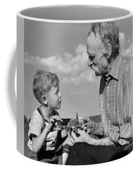 1940s Coffee Mug featuring the photograph Grandfather And Boy With Model Plane by H. Armstrong Roberts/ClassicStock