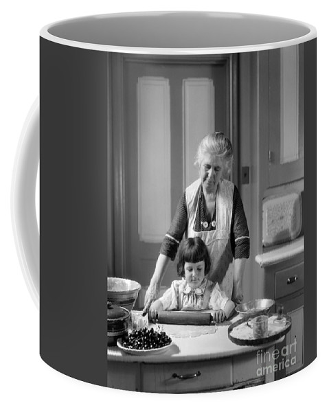 1920s Coffee Mug featuring the photograph Grandmother And Granddaughter Baking by H. Armstrong Roberts/ClassicStock