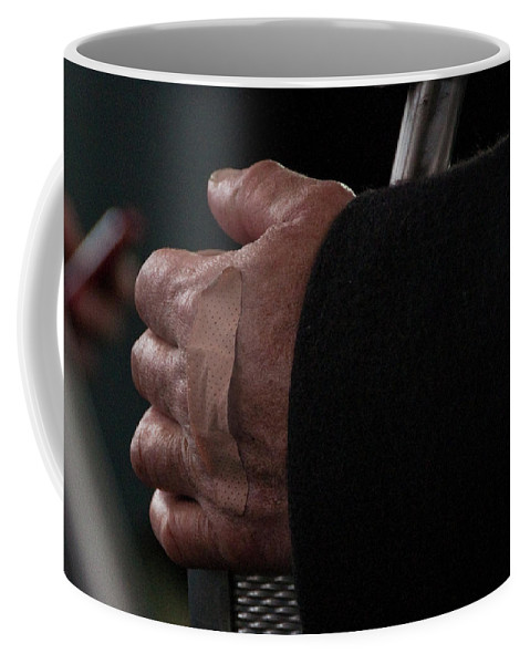 Hand Coffee Mug featuring the photograph Hand With Bandaid by Steven Natanson