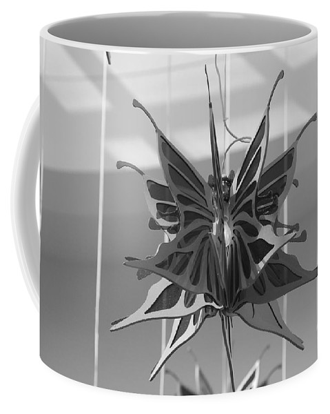 Black And White Coffee Mug featuring the photograph Hanging Butterfly by Rob Hans