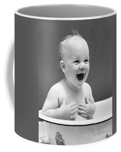 1940s Coffee Mug featuring the photograph Happy Baby In Tub, C. 1940s by H. Armstrong Roberts/ClassicStock