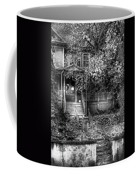 Haunted Coffee Mug featuring the photograph Haunted - Abandoned by Mike Savad