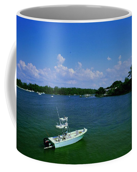Fishing Coffee Mug featuring the photograph Heading Out To Sea by Gary Wonning