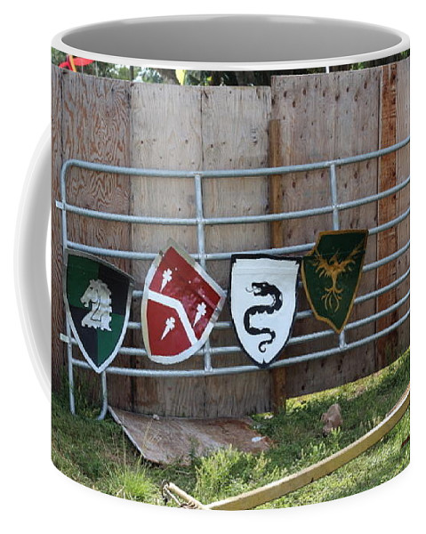 Shield Coffee Mug featuring the photograph Heraldry Shields At Renfaire by Debra K Gallagher