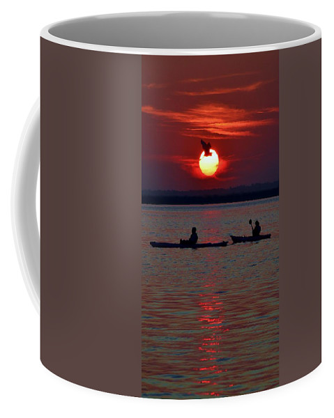 Beach Bum Pics Coffee Mug featuring the photograph Heron And Kayakers Sunset by William Bartholomew