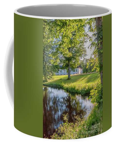 Herrevads Coffee Mug featuring the photograph Herrevads Kloster By The Riverside by Antony McAulay