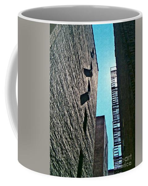 Building Coffee Mug featuring the photograph High Walls by Sarah Loft