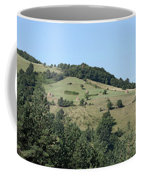 Mountain Coffee Mug featuring the photograph Hill With Haystack And Trees Landscape by Goce Risteski