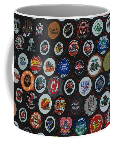 Pop Art Coffee Mug featuring the photograph Hockey Pucks by Rob Hans