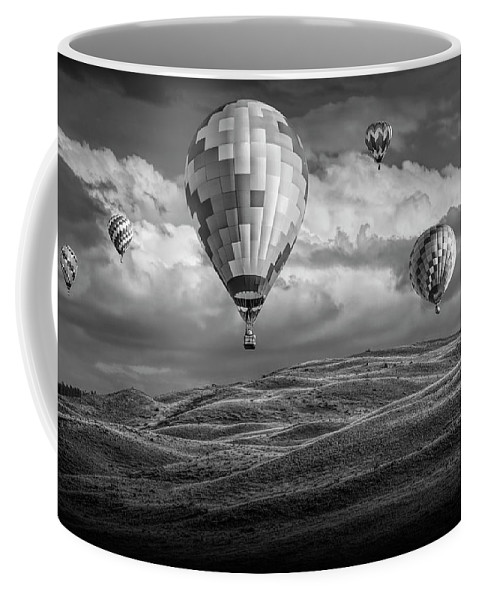 Balloon Coffee Mug featuring the photograph Hot Air Balloons In Black And White Over Fields by Randall Nyhof