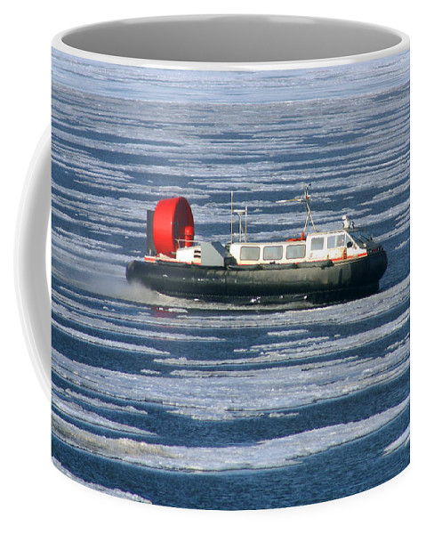 Arctic Ocean Coffee Mug featuring the photograph Hovercraft On Frozen Artic Ocean by Anthony Jones