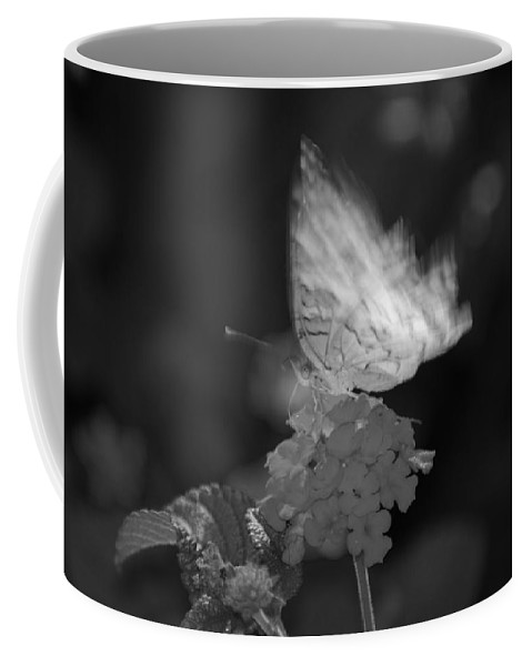 Black And White Coffee Mug featuring the photograph In Motion by Rob Hans
