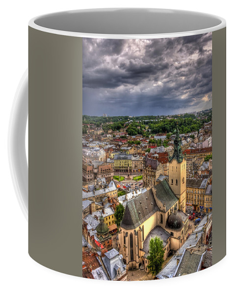 Above Coffee Mug featuring the photograph In The Heart Of The City by Evelina Kremsdorf
