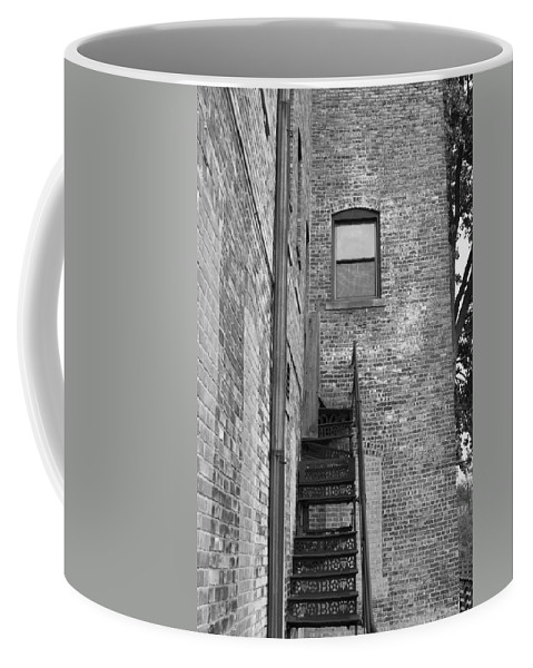Brick Coffee Mug featuring the photograph Iron Steps by Lauri Novak
