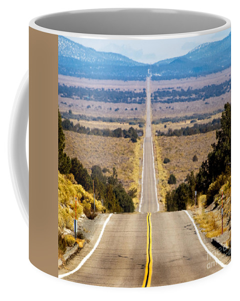 Westerm Scenes Coffee Mug featuring the photograph It Only Goes East by Norman Andrus