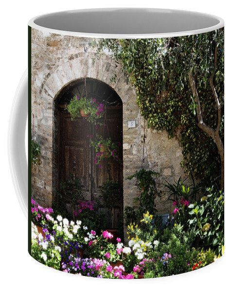 Flower Coffee Mug featuring the photograph Italian Front Door Adorned With Flowers by Marilyn Hunt