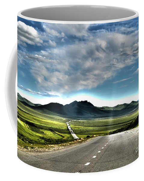 Mongolia Coffee Mug featuring the digital art It's A Long Way by Alessandro Cini