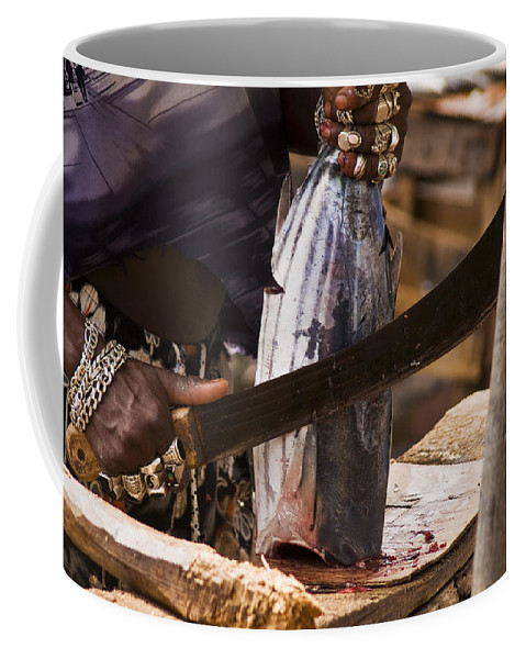 Castries Coffee Mug featuring the photograph Jeweled Hand Skinning Fish by Todd Gipstein