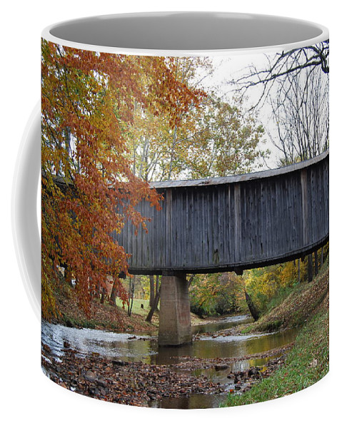 Landscape Coffee Mug featuring the photograph Kissing Bridge At Fall by Eric Liller