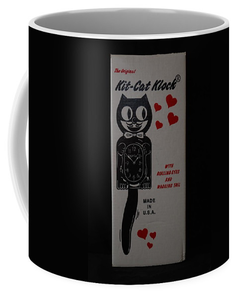 Face Coffee Mug featuring the photograph Kit Cat Klock by Rob Hans