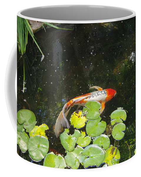 Koi Coffee Mug featuring the photograph Koi With Lily Pads B by Phyllis Spoor