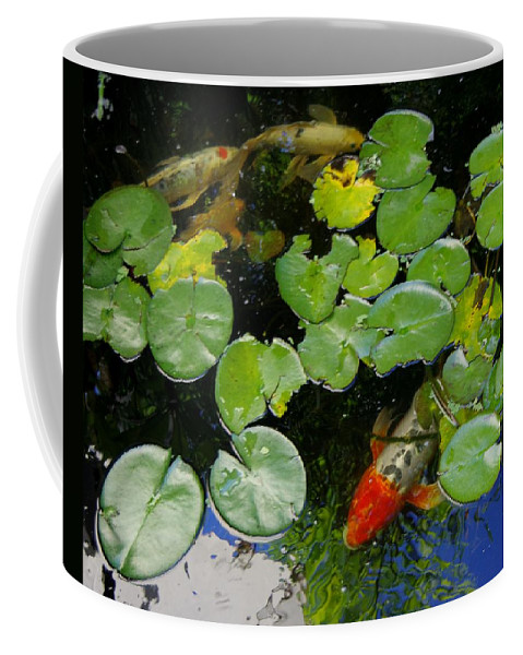 Koi Coffee Mug featuring the photograph Koi With Lily Pads D by Phyllis Spoor