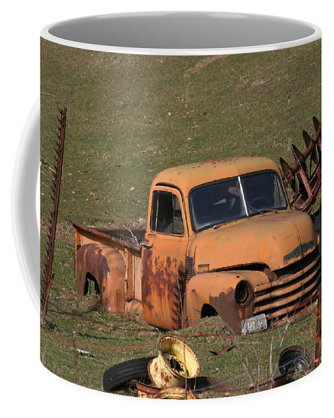 Americana Coffee Mug featuring the photograph Laid To Rest by Bjorn Sjogren