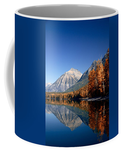 Lawrence Coffee Mug featuring the photograph Lake Mcdonald Autumn by Lawrence Boothby