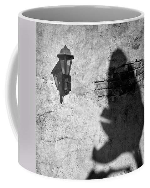 Lamp Coffee Mug featuring the photograph Lamp And Leaf by Dave Bowman
