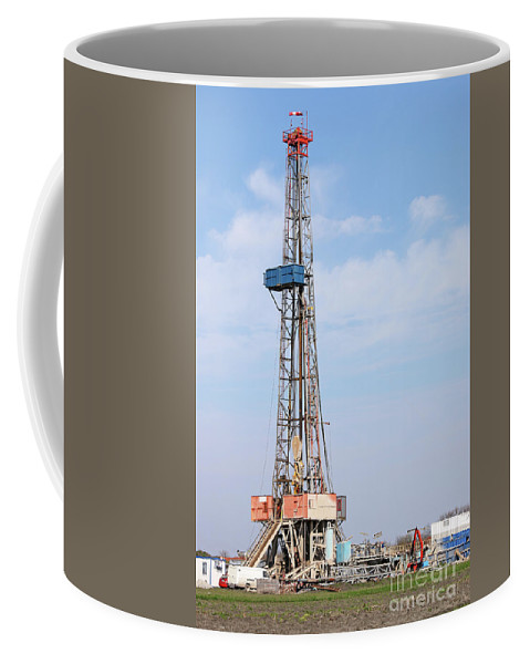 Oil Drilling Rig Coffee Mug featuring the photograph Land Oil Drilling Rig With Equipment On Oilfield by Goce Risteski