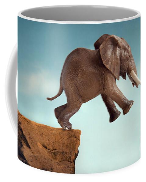 Leap Of Faith Coffee Mug featuring the photograph Leap Of Faith Concept Elephant Jumping Into A Void by Lee Avison