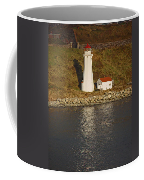 Lighthouse Coffee Mug featuring the photograph Lighthouse In Maine by Heather Coen