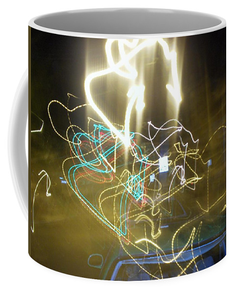 Photograph Coffee Mug featuring the photograph Lights That Attack Cars by Thomas Valentine