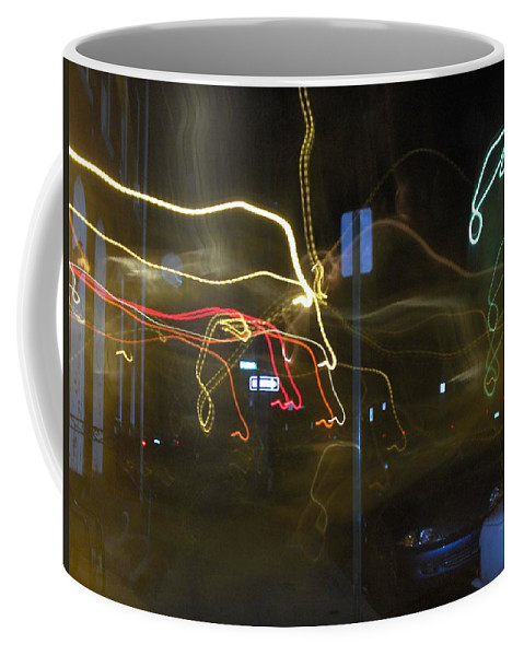Photograph Coffee Mug featuring the photograph Lights That Attack Cars Two by Thomas Valentine