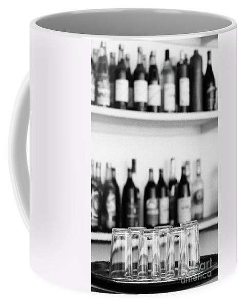 Bottles Coffee Mug featuring the photograph Liquor Bottles by Gaspar Avila