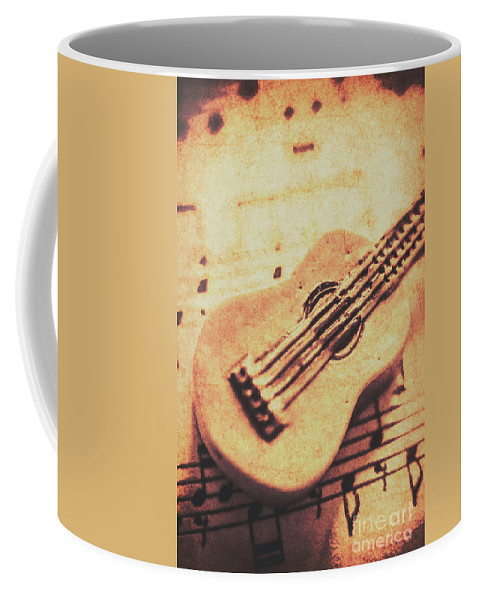 Folk Coffee Mug featuring the photograph Little Carved Guitar On Sheet Music by Jorgo Photography - Wall Art Gallery