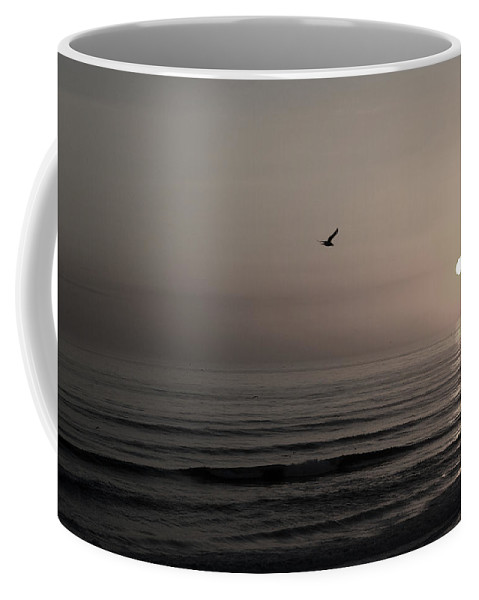 Beach Ocean Wave Sunrise Sunset Sun Bird Gull Fly Flight Water Vacation Peace Nature Relax Peace Coffee Mug featuring the photograph Lonely Flight II by Andrei Shliakhau