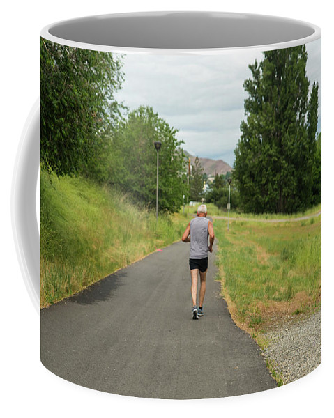 Loop Trail Runner Coffee Mug featuring the photograph Loop Trail Runner by Tom Cochran