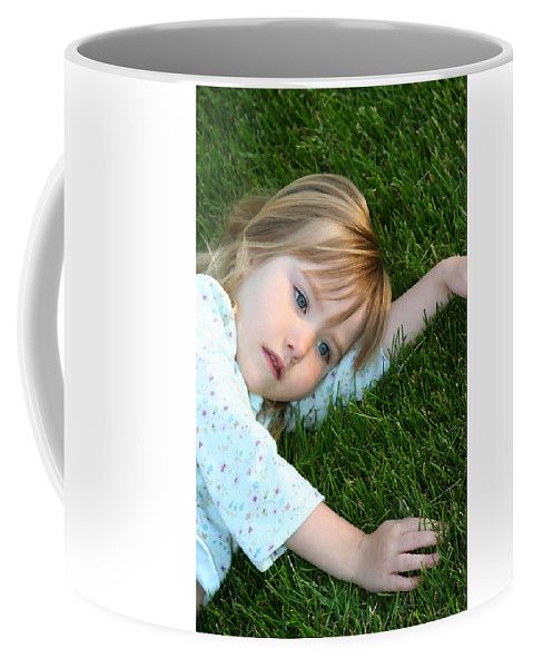Girl Coffee Mug featuring the photograph Lying In The Grass by Margie Wildblood
